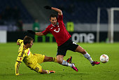 Szaboilcs Huszti of Hannover and Arseni Logashov of Makhachkala battle for the ball during the UEFA Europa League Round of 32 second leg match...