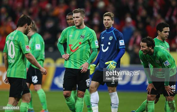 Szabolcs Huszti Andre Hoffmann RonRobert Zieler and Christian Schulz of Hannover react during the Bundesliga match between 1 FSV Mainz 05 and...