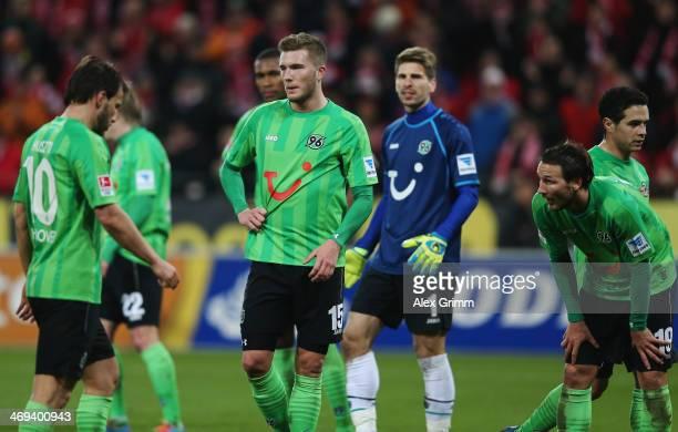 Szabolcs Huszti Andre Hoffmann RonRobert Zieler and Christian Schulz of Hannover react during the Bundesliga match between 1 FSV Mainz 05 and...