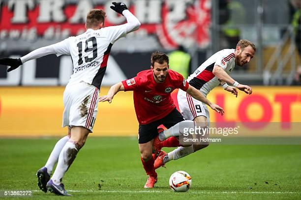 Szabolcs Huszti of Frankfurt is challenged by Moritz Hartmann Moritz Hartmann during the Bundesliga match between Eintracht Frankfurt and FC...
