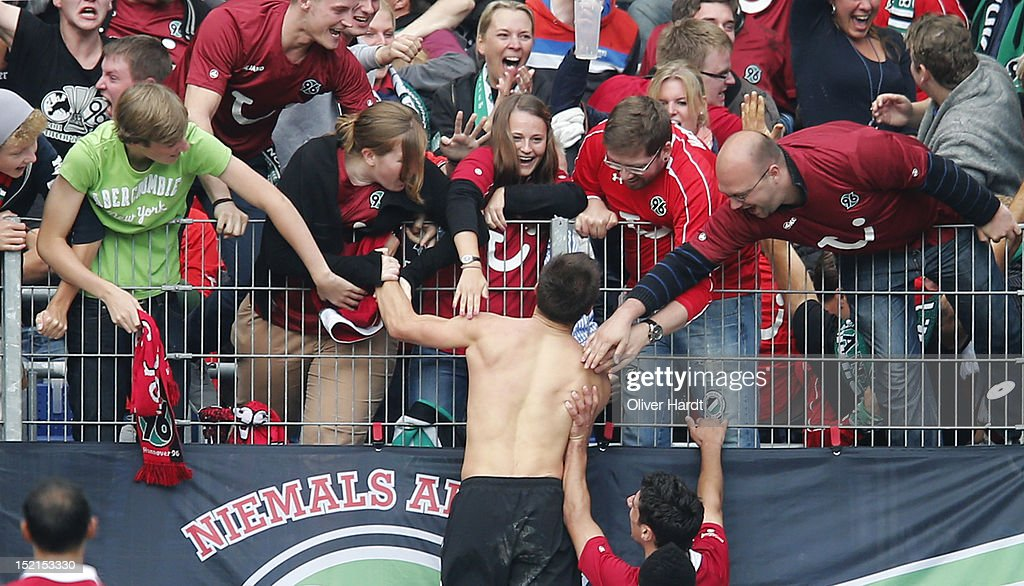 <a gi-track='captionPersonalityLinkClicked' href=/galleries/search?phrase=Szabolcs+Huszti&family=editorial&specificpeople=534472 ng-click='$event.stopPropagation()'>Szabolcs Huszti</a> of Hannover (C) celebrates after scoring their second goal with the supporters during the Bundesliga match between Hannover 96 and Werder Bremen at AWD Arena on September 15, 2012 in Hannover, Germany.