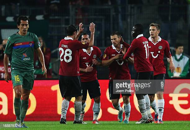 Szabolcs Huszti of Hannover celebrates with his team mates after scoring his team's first goal during the UEFA Europa League Group L match between...