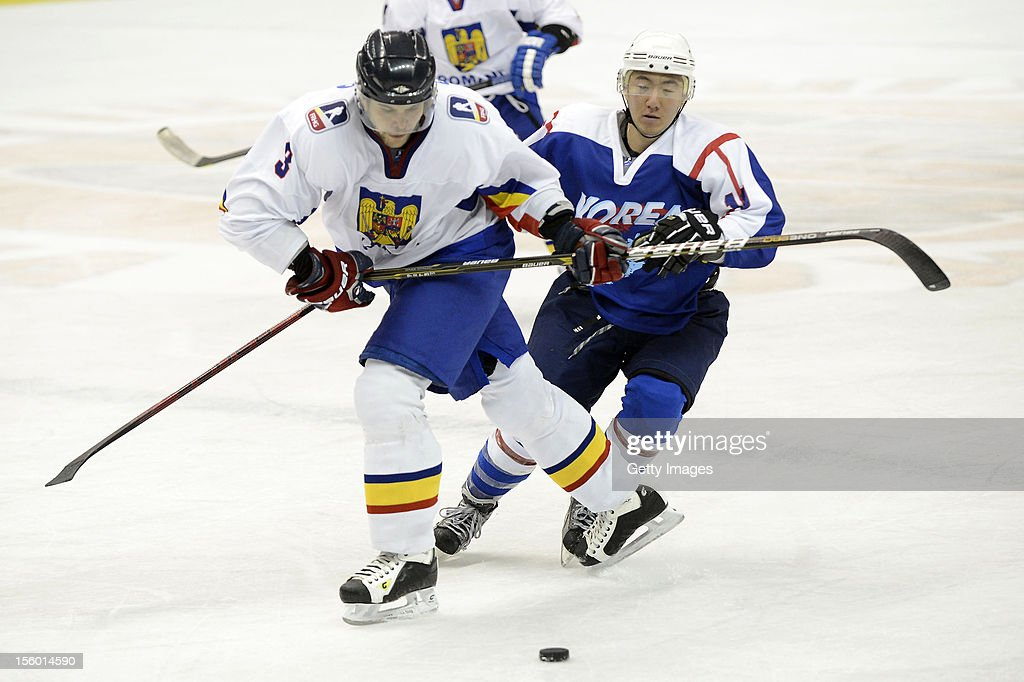 Szabolcs Papp #3 of Romania skates against Kim Hyung Joon #10 of South Korea during the Ice Hockey Sochi Olympic Pre-Qualification Group J match between South Korea and Romania at Nikko Kirifuri Ice Arena on November 11, 2012 in Nikko, Tochigi, Japan. South Korea won 2-0.