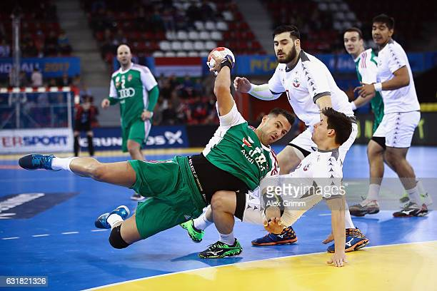 Szabolcs Szollosi of Hungary is challenged by Sebastian Ceballos and Victor Donoso of Chile during the 25th IHF Men's World Championship 2017 match...