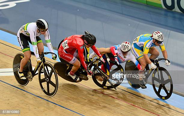 Sze Wai Lee of Hong Kong and Anastasiia Voinova of Russia crash while racing in the Women's Keirin during Day Two of the UCI Track Cycling World...