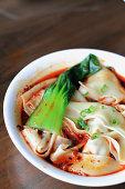 Szechuan dumplings in hot and spicy soup
