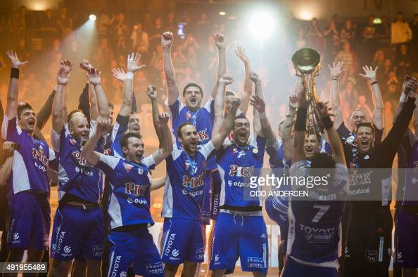 Szeged's Attila Vadkerti and fellow players celebrate with the trophy after winning the European Handball Federation cup final match between French...