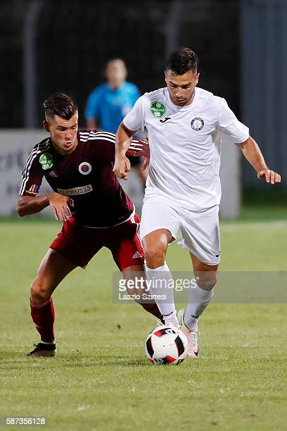 Szilveszter Hangya of Vasas FC fights for the ball with Nemanja Andric of Ujpest FC during the Hungarian OTP Bank Liga match between Vasas FC and...