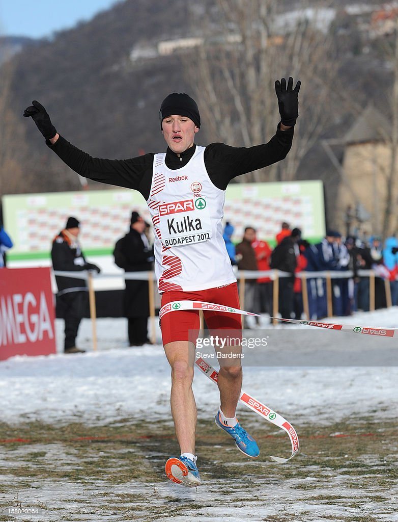 Szymon Kulka of Poland crosses the finish line to win the Junior Men's race during the 19th SPAR European Cross Country Championships on December 9, 2012 in Budapest, Hungary.