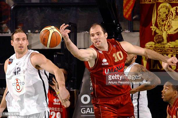 Szymon Szewczyk of Umana competes with Kevin Fletcher of Otto during the Lega Basket Serie A match between Umana Venezia and Otto Caserta at...