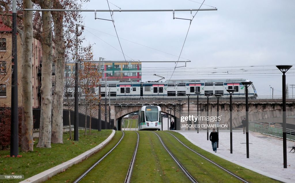 A T3b tramway operates on a test run at porte de La Villette in Paris, on December 10, 2012, ahead of the inauguration of the route linking porte de Vincennes in the east and porte de la Chapelle in the north on Paris' periphery.