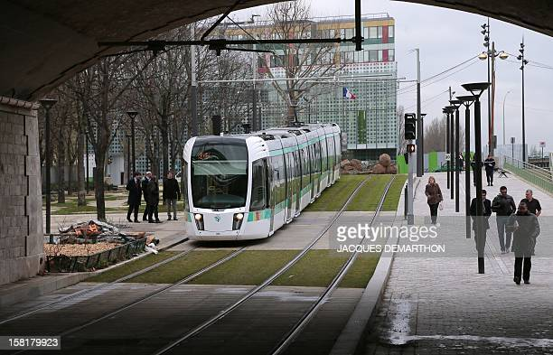 A T3b tramway operates on a test run on December 10 2012 in Paris ahead of the inauguration of the route linking porte de Vincennes in the east and...