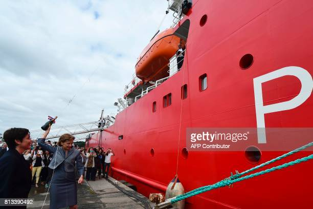 Taaf Prefect Cecile Pozzo di Borgo flanked by French Overseas Minister Annick Girardin throws a bottle on the Astrolabe ship during the inauguration...
