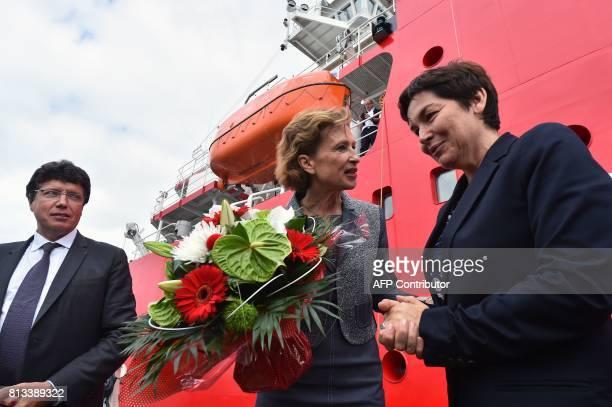 Taaf Prefect Cecile Pozzo di Borgo talks to French Overseas Minister Annick Girardin next to Piriou shipyard president Pascal Piriou during the...