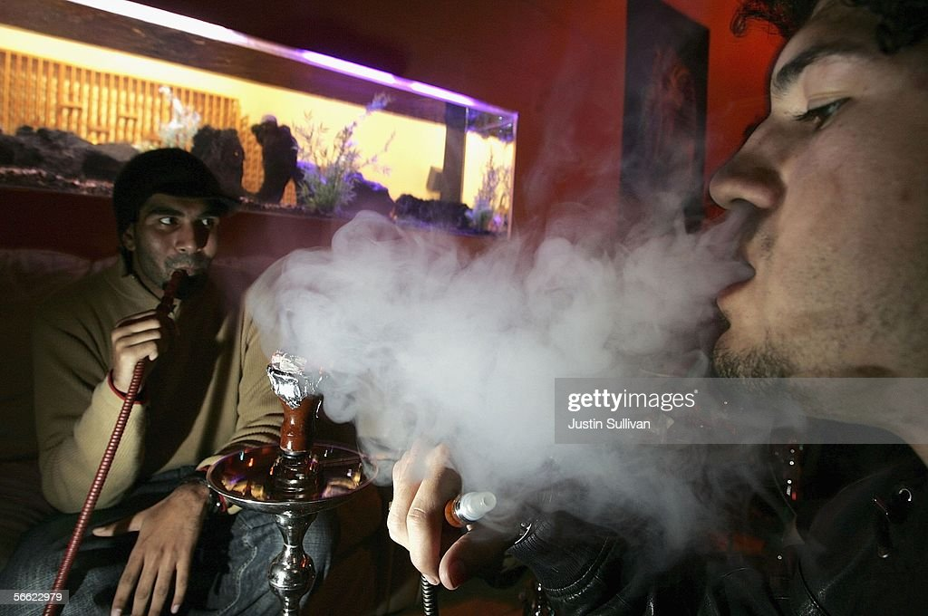 Taahir Guard (L) and Morgan Vincent smoke a hookah pipe at the Hookah Nites Cafe January 18, 2006 in San Jose, California. The ancient Middle-Eastern practice of smoking flavored tobaccos through a tall, ornate water pipe, better known as hookah, has become increasingly popular throughout the United States. Hookah lounges are becoming trendy in college towns and are appealing to people from all walks of life.