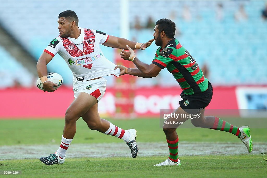 Taane Milne of the Dragons is tackled by Dane Nielsen of the Rabbitohs during the NRL Charity Shield match between the St George Illawarra Dragons and the South Sydney Rabbitohs at ANZ Stadium on February 13, 2016 in Sydney, Australia.