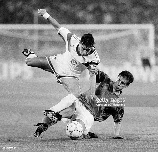 Tab Ramos of the USA hurdles a challenge from Nicola Berti of Italy during the FIFA World Cup match between Italy and the United States of America at...