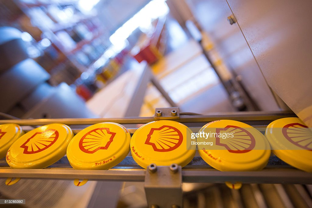 Tab seal caps for oil drums move along the production line at the Royal Dutch Shell Plc lubricants blending plant in Torzhok Russia on Tuesday March...