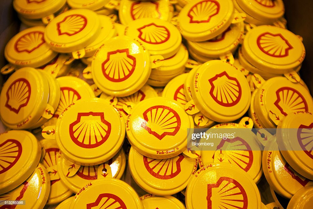 Tab seal caps for oil drums sit in a tray after pressing at the Royal Dutch Shell Plc lubricants blending plant in Torzhok Russia on Tuesday March 1...