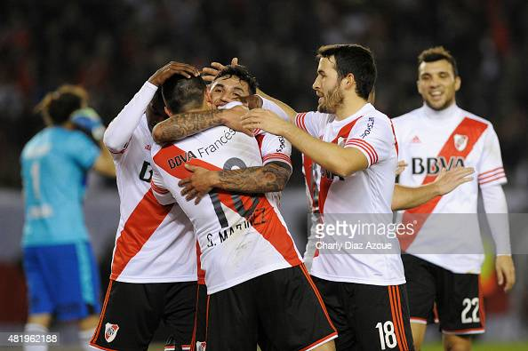 Tabare Viudez of River Plate celebrates with teammates after scoring his team's third goal during a match between River Plate and Colon de Santa Fe...