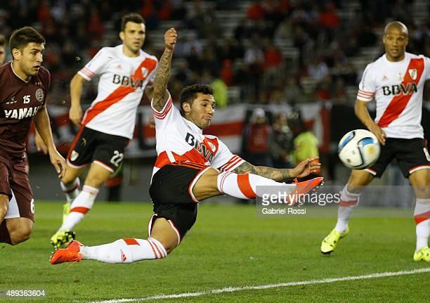 Tabare Viudez of River Plate kicks the ball during a match between River Plate and Lanus as part of 25th round of Torneo Primera Division 2015 at...