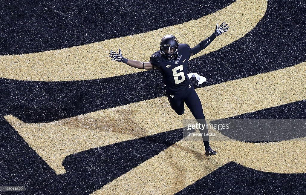 Tabari Hines of the Wake Forest Demon Deacons reacts after scoring a touchdown against the Louisville Cardinals during their game at BBT Field on...