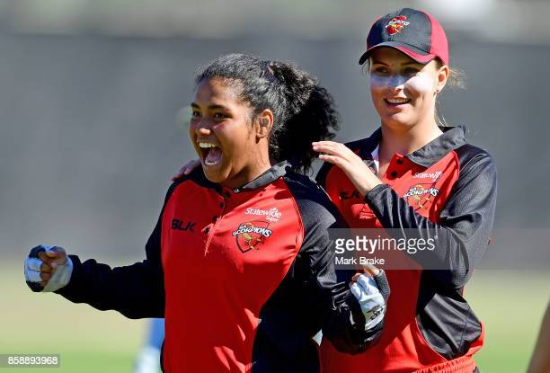Tabatha Saville and Alex Price celebrate the win after the WNCL match between South Australia and Tasmania at Adelaide Oval No2 on October 8 2017 in...