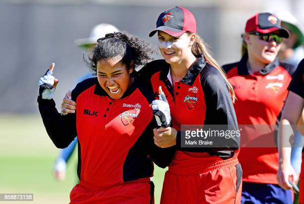 Tabatha Saville and Alex Price celebrate the win over Tasmania during the WNCL match between South Australia and Tasmania at Adelaide Oval No2 on...