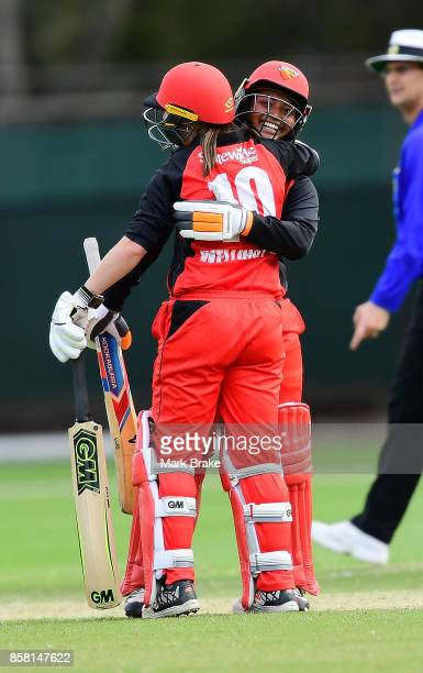 Tabatha Saville celebrates her 50 with Amanda Wellington during the WNCL match between South Australia and Western Australia at Adelaide Oval No2 on...