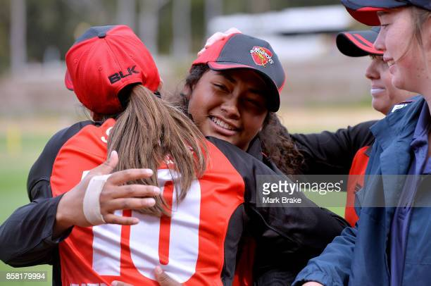 Tabatha Saville is hugged by Amanda Wellington after receiving her Scorpions cap before the WNCL match between South Australia and Western Australia...