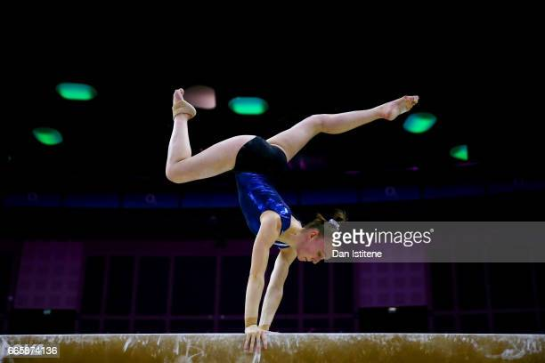 Tabea Alt of Germany takes part in a practice session on the beam during previews to the iPro Sport World Cup of Gymnastics at The O2 Arena on April...