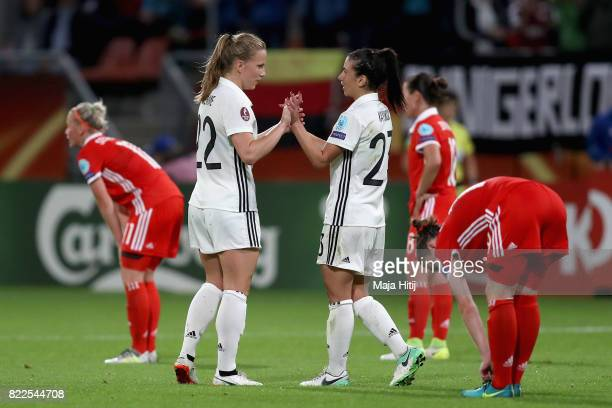 Tabea Kemme of Germany and Hasret Kayikci of Germany celebrate victory together after the Group B match between Russia and Germany during the UEFA...