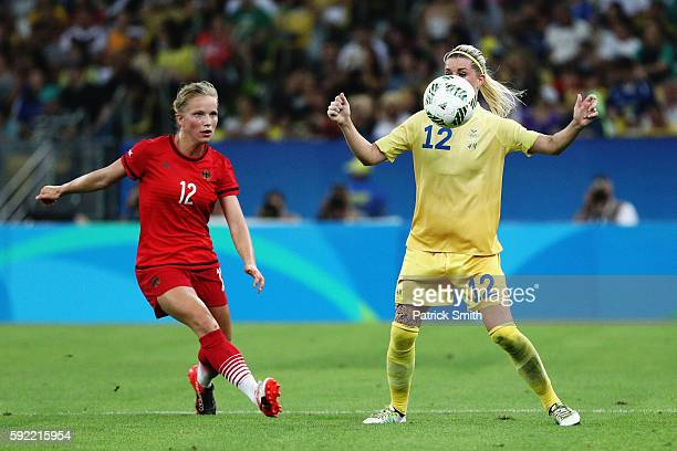 Tabea Kemme of Germany challenges Olivia Schough of Sweden during the Women's Olympic Gold Medal match between Sweden and Germany at Maracana Stadium...
