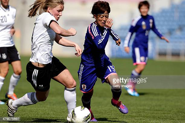 Tabea Kemme of Germany challenges Saori Ariyoshi of Japan during the Algarve Cup final match between Germany and Japan on March 12 2014 in Faro...