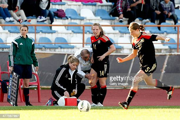 Tabea Kemme of Germany gets assistance out of lines while Annike Krahn restarts the Algarve Cup 2014 match between Germany and China on March 07 2014...
