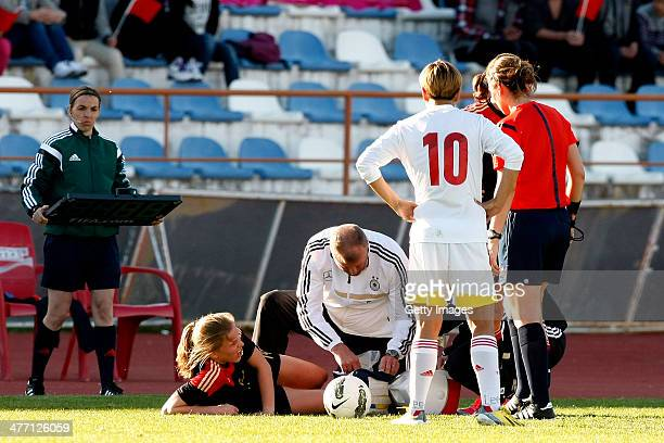 Tabea Kemme of Germany receieves medical assistance on the pitch during the Algarve Cup 2014 match between Germany and China on March 07 2014 in...