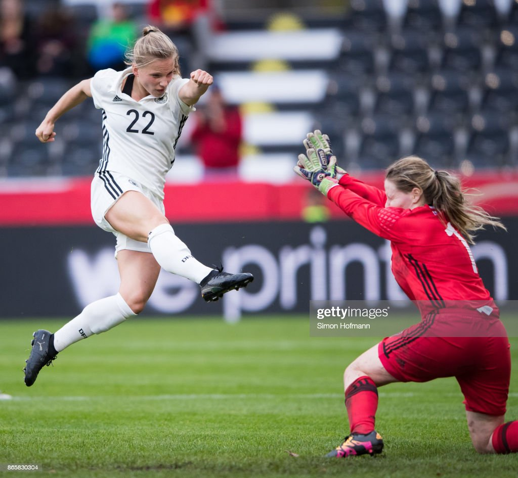 Tabea Kemme of Germany scores her team's third goal against goalkeeper Monika Biskopstoe of Faroe Islands during the 2019 FIFA Women's World Championship Qualifier match between Germany and Faroe Islands at mechatronik Arena on October 24, 2017 in Grossaspach, Germany.