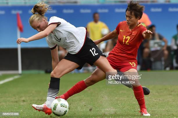 TOPSHOT Tabea Kemme of Germany vies for the ball with Shuang Wang of China during their Rio 2016 Olympic Games women's quarterfinal football match at...