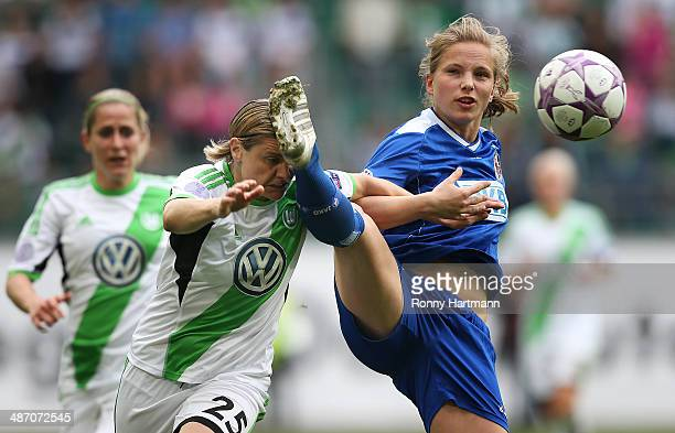 Tabea Kemme of Potsdam and Martina Mueller of Wolfsburg vie for the ball during the second UEFA Women's Champions League semi final match between VfL...