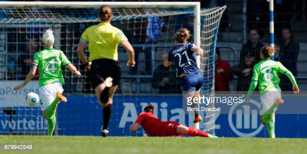 Tabea Kemme of Turbine Potsdam scores her team's first goal against goalkeeper Almuth Schult of VfL Wolfsburg during the Allianz Women's Bundesliga...