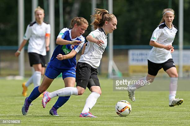 Tabea Schuett of Potsdam battles for the ball with Sophia Kleinherne of Guetresloh during the U17 Girl's German Championship final match between 1FFC...