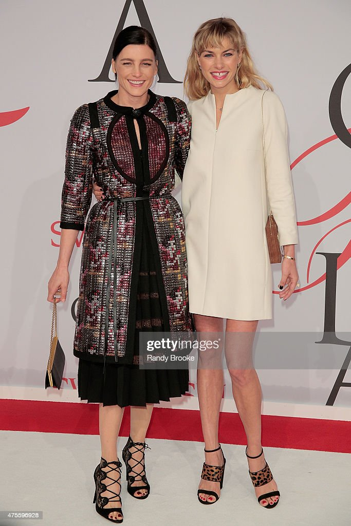 Tabitha Simmons who won accessories designer of the year poses with Jessica Hart at the 2015 CFDA Fashion Awards at Alice Tully Hall at Lincoln Center on June 1, 2015 in New York City.