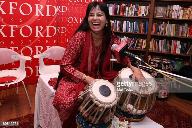 Tabla Player Anuradha Pal poses at the Oxford Book Store in New Delhi on July 24 2009