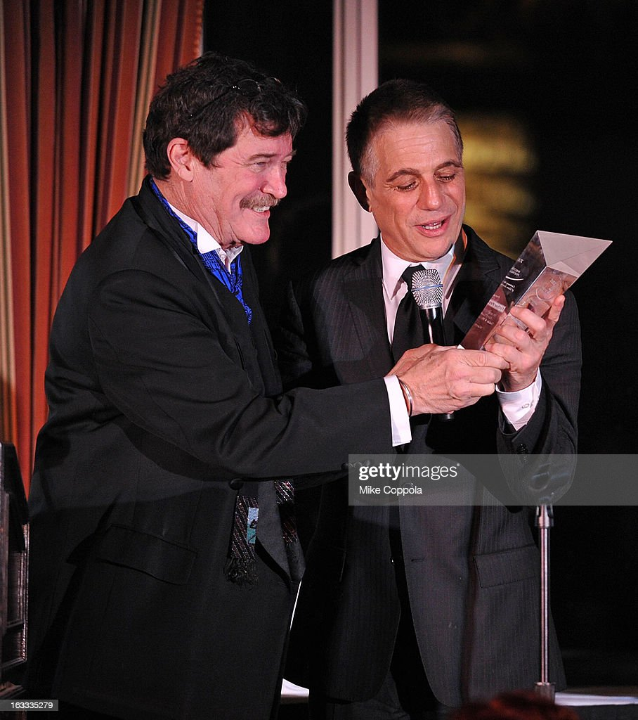 Table 4 Writers Foundation President Josh Gaspero (L) presents an award that actor Tony Danza accepts on Father Peter Colapietro's behalf at the Table 4 Writers Foundation 1st Annual Awards Gala on March 7, 2013 in New York City.
