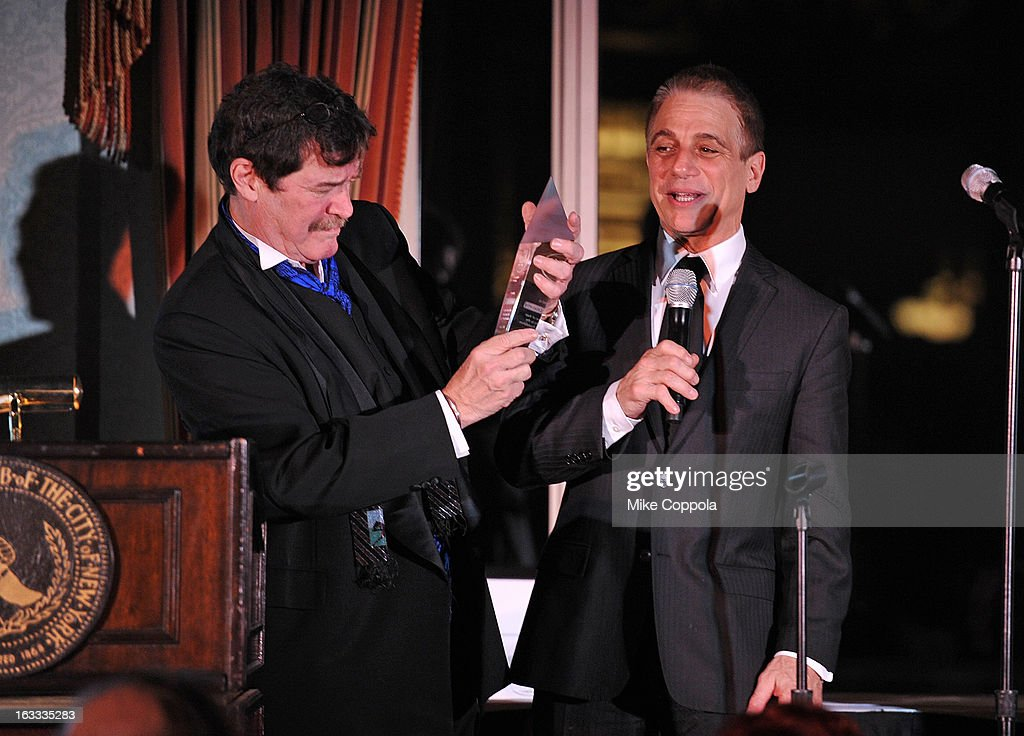 Table 4 Writers Foundation President Josh Gaspero (L) presents an award that actor <a gi-track='captionPersonalityLinkClicked' href=/galleries/search?phrase=Tony+Danza&family=editorial&specificpeople=203133 ng-click='$event.stopPropagation()'>Tony Danza</a> accepts on Father Peter Colapietro's behalf at the Table 4 Writers Foundation 1st Annual Awards Gala on March 7, 2013 in New York City.