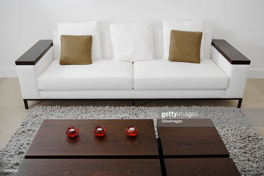 Table and a couch in a living room : Stock Photo