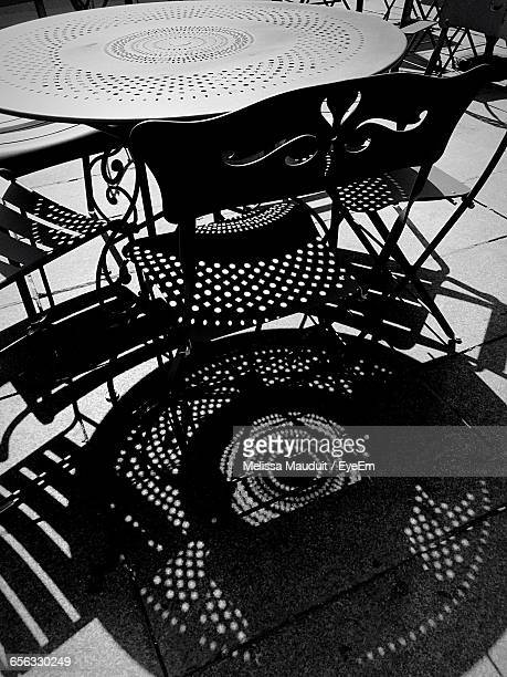 Table And Chairs At Sidewalk Cafe