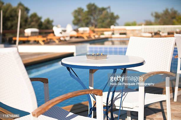 Table and chairs near swimming pool