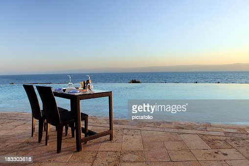 Table and chairs set overlooking the water