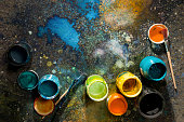 Table artist spattered with paint, paint cans close